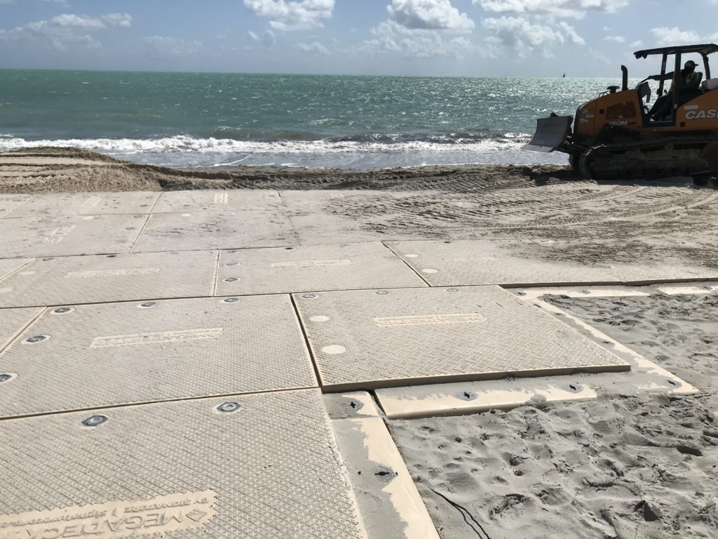 Ultra-durable MegaDeck HD access mats offered ground protection as construction crews trucked 31,000 cu yds. of sand across the Key Biscayne shoreline.